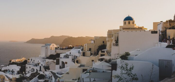 Beautiful houses in Greece, symbolizing buying a house in another country.