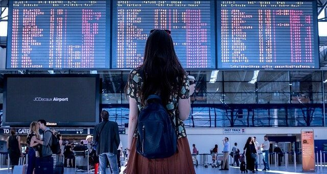 A girl standing at an airport terminal